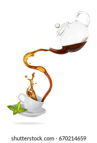Porcelain white cup with splashing tea from jug, separated on white background. Hot drink with splash, beverages and refreshment. Very high resolution image