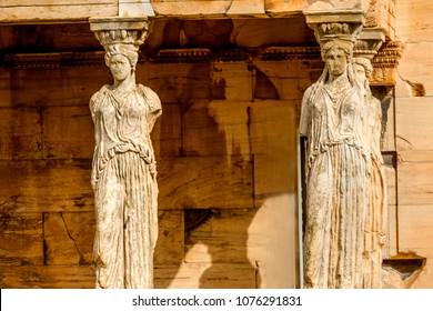 Porch Caryatids Ruins Temple of Erechtheion Acropolis Athens Greece.  Greek maidens columns Temple of Erechtheion for a former Athenian king.  Acropolis is symbol of Athens