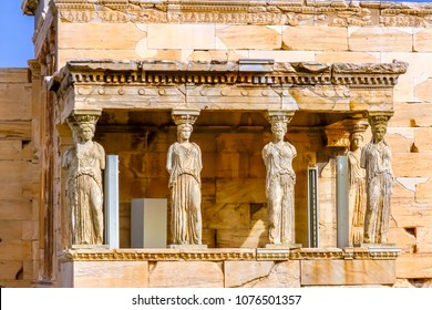Porch Caryatids Ruins Temple of Erechtheion Acropolis Athens Greece.  Greek maidens columns Temple of Erechtheion for a former Athenian king.  Acropolis is symbol of Athens