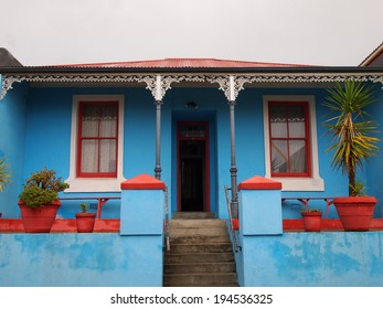 Porch. The front facade of the house. Bright colors. Bo-Kaap. Malay Quarter. Cape Town. South Africa
