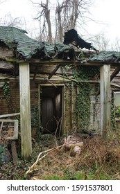 Porch leading to a doorway of a rotting, run down house