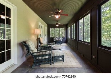 Porch in luxury home with dark wood paneling