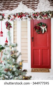 Porch with red door and christmas decorations
