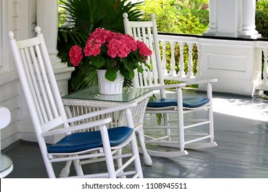 porch with rocking chairs and flowers