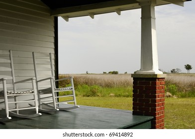 Porch with rocking chairs overlooking salt marsh