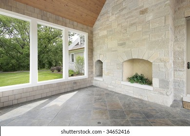 Porch with stone fireplace