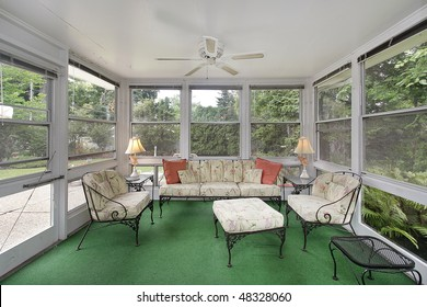 Porch in suburban home with green flooring