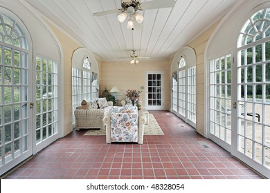 Porch in suburban home with red brick floor