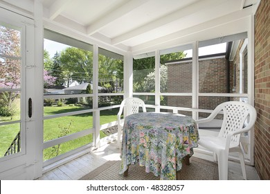 Porch in suburban home with stairs to yard