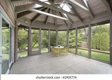 Porch with wood ceiling beams