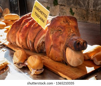 porchetta toscana, a traditional Tuscan slow roasted pork, and sandwiches for sale in the downtown plaza market in San Gimignano, Italy