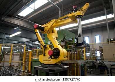 PORDENONE, ITALY - September 4, 2017 - Italian company specialized in construction of grids for both free standing and integrated cooking hobs in enamelled wire iron - robot