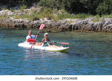 POREC, CROATIA - JULY 02: Senior couple kayaking along the seashore in July 2015.