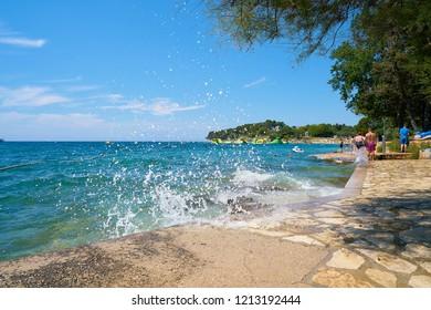 POREC, CROATIA – JULY 17, 2018:  Beach on the Adriatic Sea at the resort Zelena Laguna near Porec in Croatia