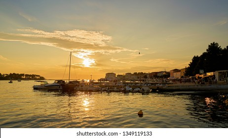 POREC, CROATIA – JULY 17, 2018: Port in Porec on the Adriatic coast in Croatia at sunset. Porec is one of the most popular port cities in Croatia.