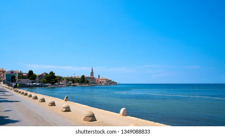 POREC, CROATIA – JULY 19, 2018: Promenade with the historic old town of Porec in Croatia. Porec is one of the most popular port cities in Croatia.