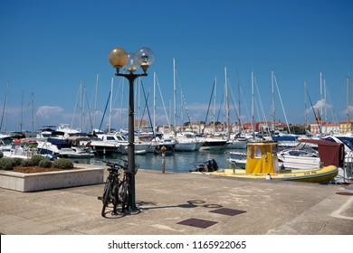 POREC, CROATIA – JULY 22, 2018: View of the marina in Porec in Croatia with the popular promenade