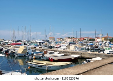 POREC, CROATIA – JULY 22, 2018: Marina with many ships in front of the old town of Porec in Croatia