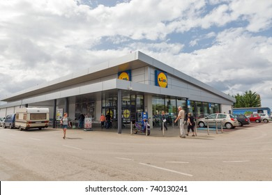 POREC, CROATIA - SEPTEMBER 12, 2017: Unrecognized people visit Lidl store. Lidl is a German global discount supermarket chain, that operates over 10,000 stores across Europe.