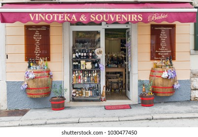 POREC, CROATIA - SEPTEMBER 21, 2017: Babic vinoteka and souvenirs shop facade in Old Town. Porec is a town almost 2,000 years old and municipality on the western coast of the Istrian peninsula.