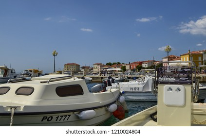 Porec, Istria, Croatia. August 2018. Silence reigns in the harbor, the pitching of the boats animates the scene. Some owners take advantage of the stop to order the inside of their boat.