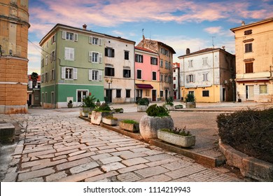 Porec, Istria, Croatia: picturesque cityscape at sunrise of an ancient square in the old town