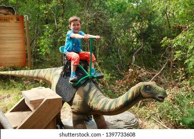 Porec, Istria, Croatia - September 2, 2017. Ride a dinosaur in Dinopark Funtana, the first and the largest theme park in Croatia.