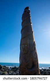 Porirua / New Zealand - July 26 2020: Maori carving Pou Tangaroa standing in Pukerua Bay