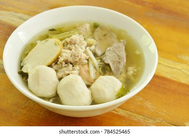 pork ball and liver with bean sprout soup on bowl