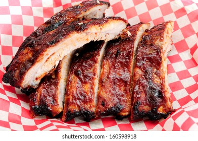 pork bbq ribs, meaty ribs smothered with bbq sauce