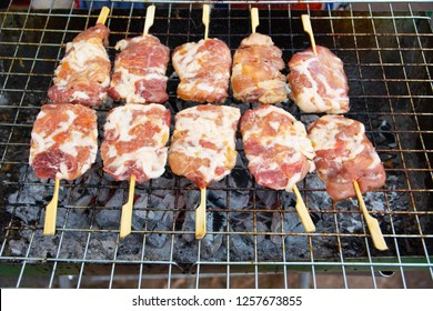 Pork being grilled on barbecue grill