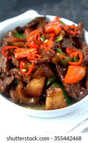 Pork belly cooked with soya sauce, garnish with chili. Famous chinese food