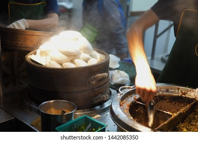 Pork belly gua bao is a taiwan street food. steam traditional white bun and stew pork belly