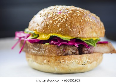 Pork Belly Sandwich with Red Cabbage on a Sesame Bun
