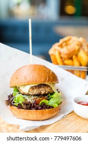 pork burger with onion rings and french fries - unhealthy food