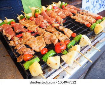 Pork and chicken barbecue on stick selling in the market as Thai famous street food