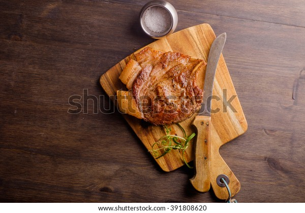 Pork Chop on chopping board ready to be eaten