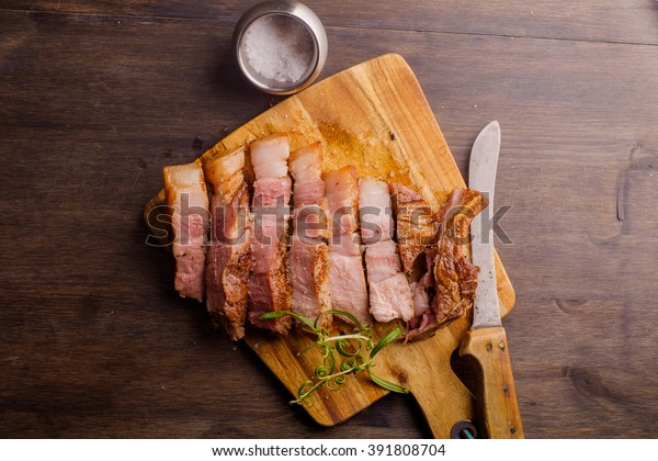 Pork Chop on chopping board ready to be eaten