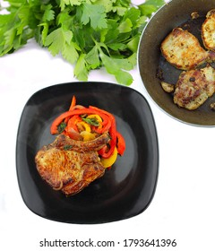 Pork chop with roasted peppers
