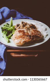 pork chops with broccoli with rice and mushroom sauce