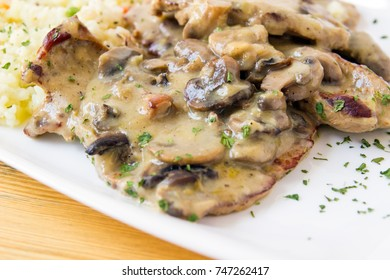 Pork chops with mushrooms and mushroom sauce