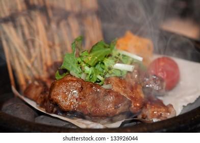 Pork chops served with wine lees sauce.