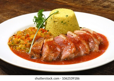 pork, couscous and bittersweet sauce