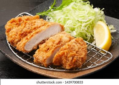 pork cutlet served with shredded cabbage
