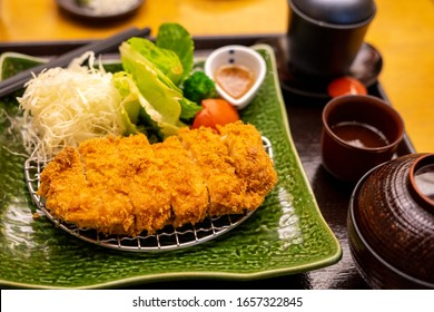 Pork Cutlet Set With miso soup Poached egg and vegetable salad In the style of Japan The taste is very delicious like eating in Japan. From a restaurant near my house