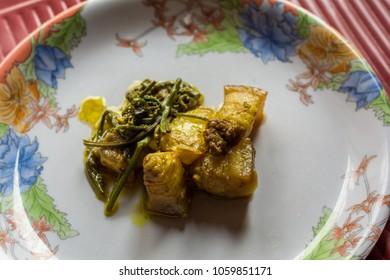 pork with Fiddlehead fern. Assamese cuisine. Indian food. traditional Assamese pork disk.