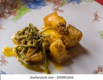 pork with Fiddlehead fern. Assamese cuisine. Indian food. traditional Assamese pork disk