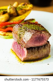 Pork Fillet steak cuts with grilled vegetable garnish and sauce