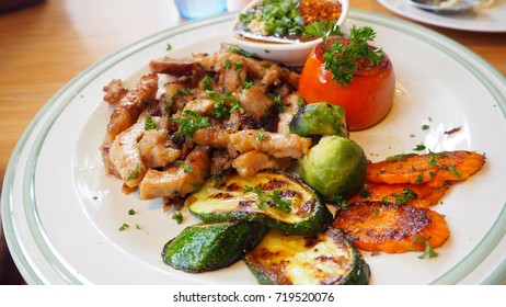pork grill and cucumber , carrot , tomato