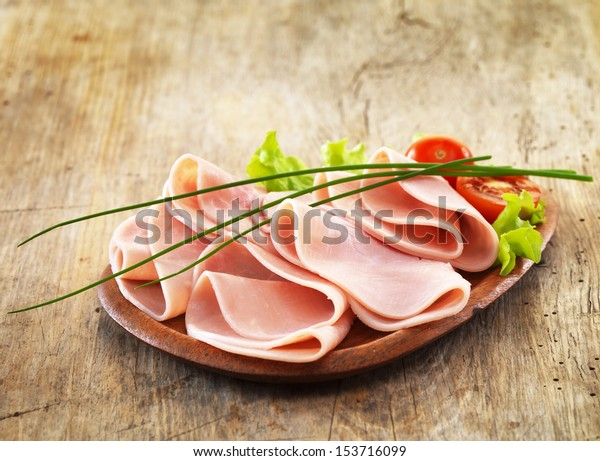 pork ham on wooden plate